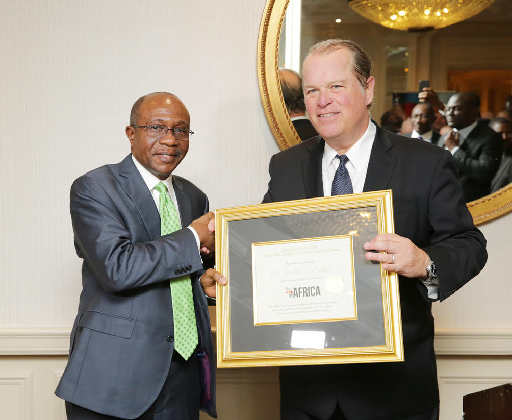 Governor of Central Bank of Nigeria, Godwin Emefiele (left) receiving the Forbes Best of Africa lnnovative Banking Award 2017 from the CEO, Forbes Custom Business Solutions, Mike Furlong at the Wilard Continental Hotel, Washington DC on Thursday, 12/10/2017