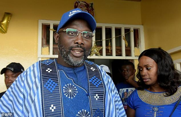 Hundreds gather to greet George Weah as election authorities confirm he has won the Liberian presidency