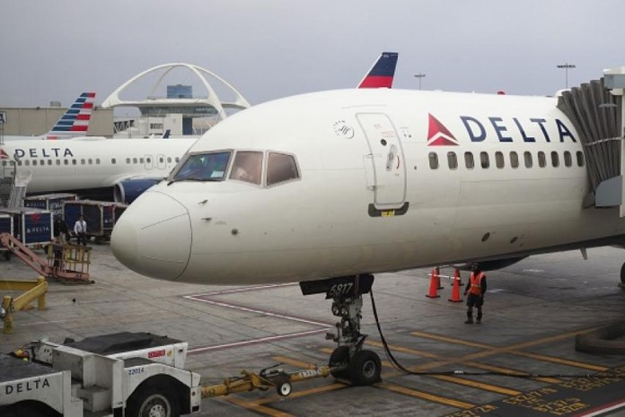 Delta air plane's engine engulfed in flame mid-air