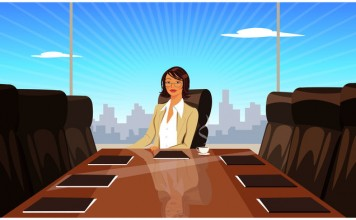 Businesswoman sitting at conference table in boardroom