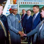 Buhari is received by a delegation of Russians in Sochi.