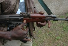 gunmen carrying Ak-47 riffle