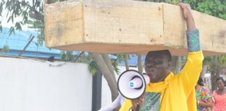 Pastor With Coffin