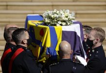 The coffin arrives at St George's Chapel for the funeral of Britain's Prince Philip inside Windsor Castle in Windsor, England, Saturday, April 17, 2021. (Kirsty Wigglesworth/Pool via AP)