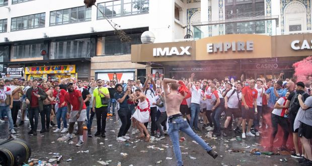 England supporters throw a tree as they gather in Leicester Square