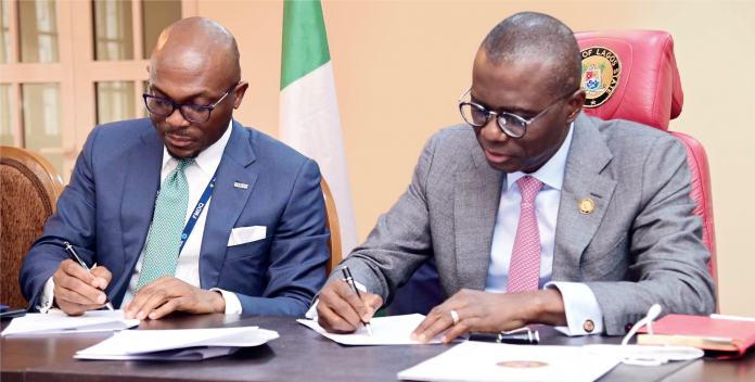 R-L: Lagos State Governor Babajide Sanwo-Olu and Chief Executive Officer, FMDQ Group, Mr. Bola Onadele Koko, at the MoU signing ceremony between the Lagos State Government and the Nigerian Green Bond Market Development Programme, held in Lagos on 14/9/2021. Photo: Peace Udugba.